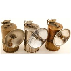 Three Early Vertical Justrite Carbide Lamps