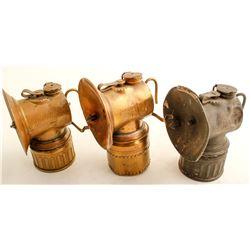 Three Justrite Lamps