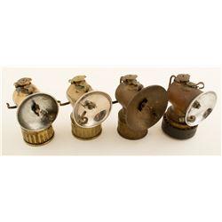 Four Justrite Lamps