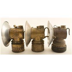 Three Small Justrite Lamps