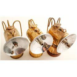 Three Brass Justrite Lamps