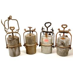 Four Large Carbide Lamps