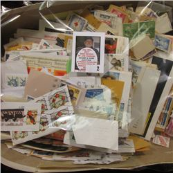 Shoe box full of old used Postage Stamps.