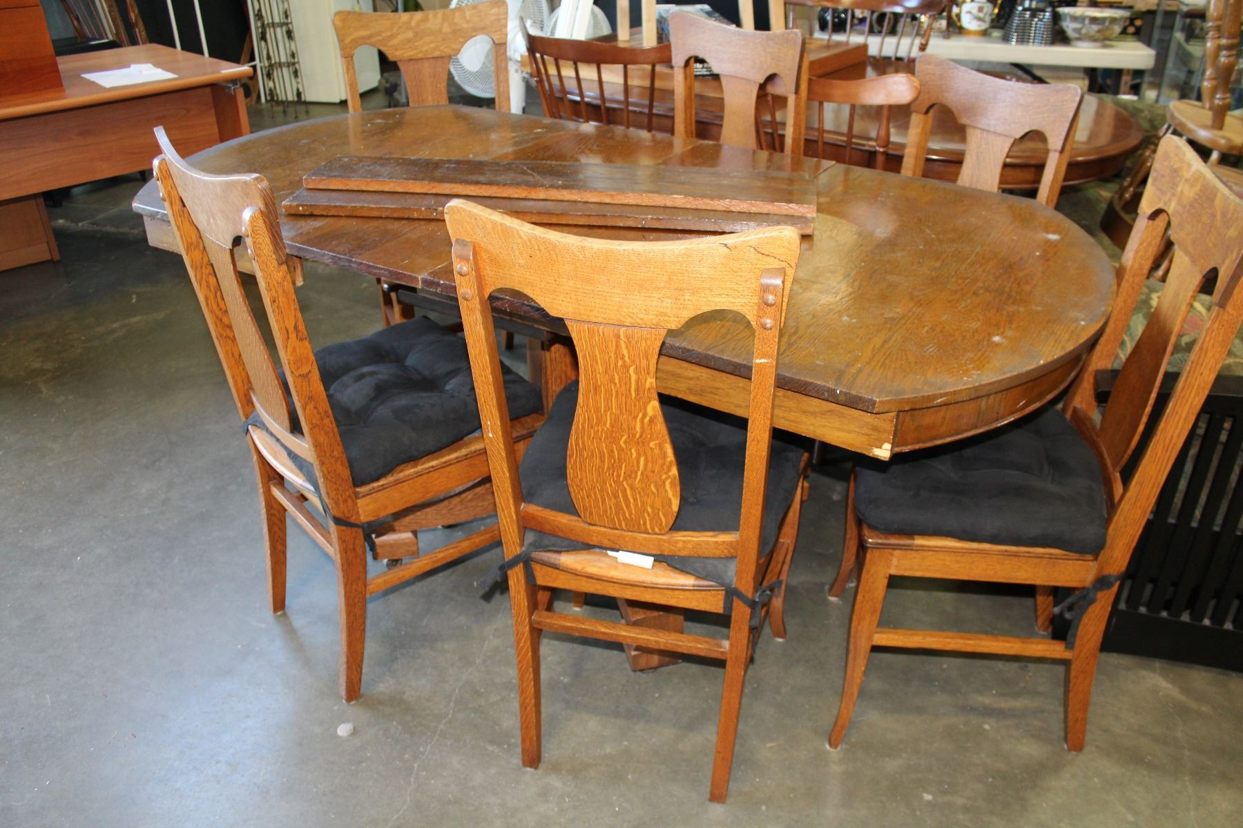 Antique Tiger Oak Dining Table With Four Leafs And Six T Back Chairs