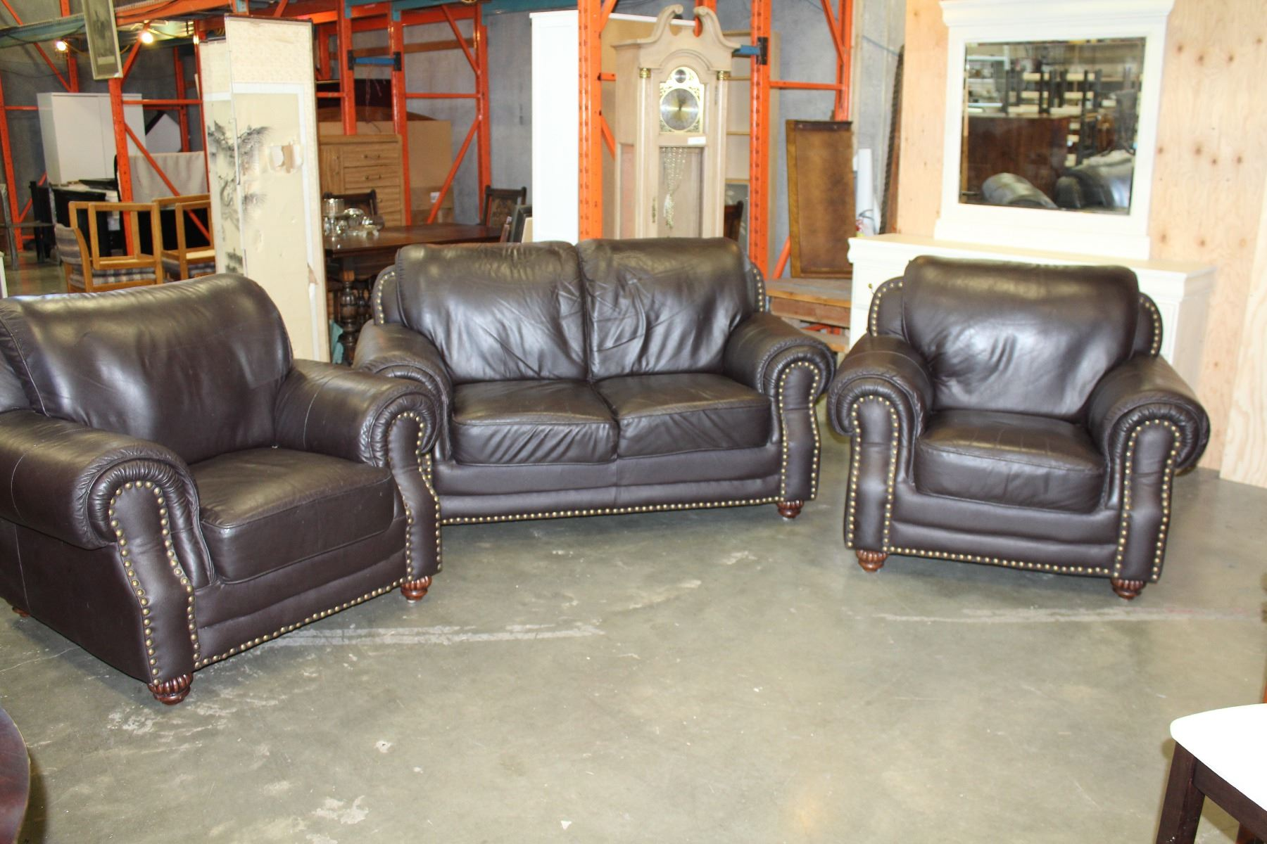 Dark Brown Leather Loveseat And Two Matching Chairs