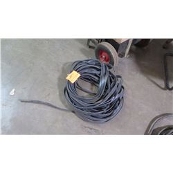 Coil of Black-Coated Cable