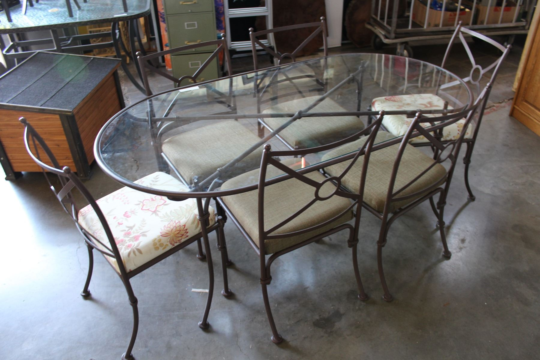 Image 1 wrought iron glass top patio table and six chairs