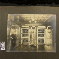 "Pair of black & white photos of the interior of ""The First National Bank""."