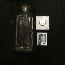 Clear Glass Pharmaceutical bottle without cork; & ca. 1880 Nickelodean Indian design Token.