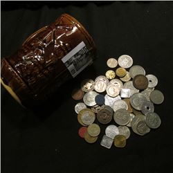"""Ceramic Mug """"Old Milwaukee"""" with a large group of unsorted foreign coins and tokens."""