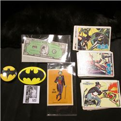 Group of Batman memorabilia including cards, scrip, and a pin-back.