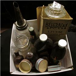 Several old bottles including an antique one Quart Oil bottle.