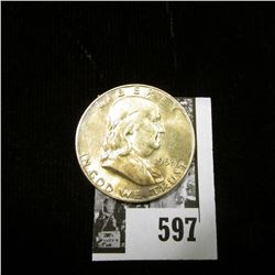 1953 D Franklin Half Dollar, lightly toned Uncirculated.