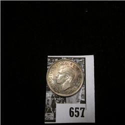 1937 Canada Quarter, Superb Uncirculated and attractively toned with gold higllights.