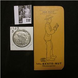 """1923 S U.S. Peace Silver Dollar, EF; & a booklet """"Have you met our salesman Ole Nutt nicknamed """"Nut"""