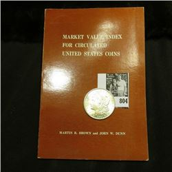 """1921 P U.S. Morgan Silver Dollar, Brilliant Uncirculated; and a book titled """"Market Value Index For"""