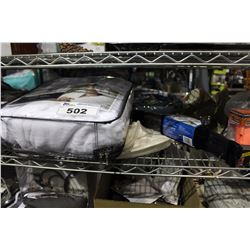 SHELF LOT OF DEPARTMENT STORE ITEMS INCLUDING COAT HANGERS AND TERRY CLOTH ROBE AND MORE