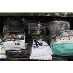 SHELF LOT OF MISC DEPARTMENT STORE ITEMS INCLUDING BEDDING, BATHMAT, TOILET SEAT AND MORE