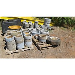 CONTENTS OF 4 PALLETS: USED MISC. MANLIFT WHEELS