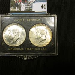 1964 P & D Gem BU Kennedy Half Dollars in a special case. Small crack in case.