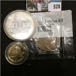 """""""Benjamin Franklin Since 1928/1929 100-Banknote"""" Medal, encased; 1948 Irish Large Penny in a Littlet"""