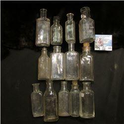 """(11) Cork Style and (1) Bake-a-lite Lid Medicine Bottles, includes an """"Ambert Ville Rubber Co."""" Bott"""