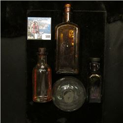 """Glass hand blown globe; and an Amber cork style amber bottle embossed """"The Piso Company"""" & """"Hazeltin"""