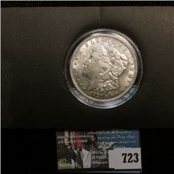 1921 P U.S. Morgan Silver Dollar, Brilliant Uncirculated. Mounted in a special holder, which has a l