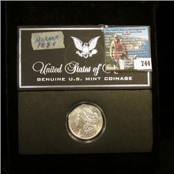 1886 P Morgan Silver Dollar, Brilliant Uncirculated encapsulated in a Special holder.