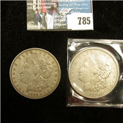 Pair of 1921 D U.S. Morgan Silver Dollar, VF-EF. With C.O.A. from the American Historic Society.
