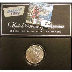 1890 P Morgan Silver Dollar, AU, in a special holder.
