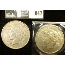 Pair of 1922 P U.S. Peace Silver Dollars, EF-AU, one with C.O.A. from the American Historical Societ