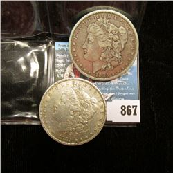 Pair of 1885 P U.S. Morgan Silver Dollars. VF-EF.