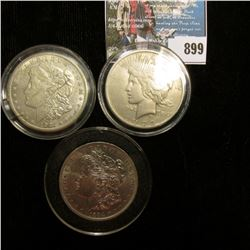 1921 S U.S. Morgan Silver Dollar, AU, Encased in a cracked case; 1884 O Brilliant Uncirculated Morga