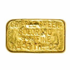 "Colorado. Cripple Creek. 1.253 Ounces. .999 Fine. About 1 1/8"" x ½""."