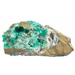 Huge natural Colombian emerald specimen in matrix.