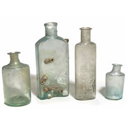 Four small handblown glass bottles (1800s).