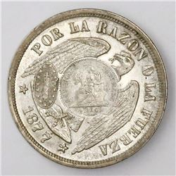 "Guatemala, 1 peso, ""1/2 real"" counterstamp of 1894 on a Santiago, Chile, 1 peso, 1877."