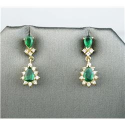Gorgeous ladies drop earrings set with four  intense green emeralds weighing approx. 1.50  carats an