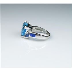 Gorgeous ladies ring set with a fine  Trilliant cut blue Topaz and black Opal inlay  with side diamo