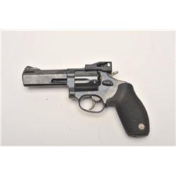 "Taurus Tracker Model DA revolver, .44 Magnum  caliber, 4"" ported barrel, blued finish, hard  rubber"