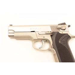 """Smith & Wesson Model 4003 semi-automatic  pistol, .40 S&W caliber, 4"""" barrel,  stainless, checkered"""