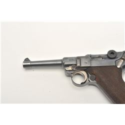 """Luger semi-automatic pistol by DWM, 9mm  caliber, 4"""" barrel, blued finish, checkered  wood grips, S/"""