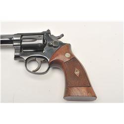 """Smith & Wesson DA revolver, 5-screw frame,  .22LR caliber, 6"""" barrel, blued finish,  checkered wood"""