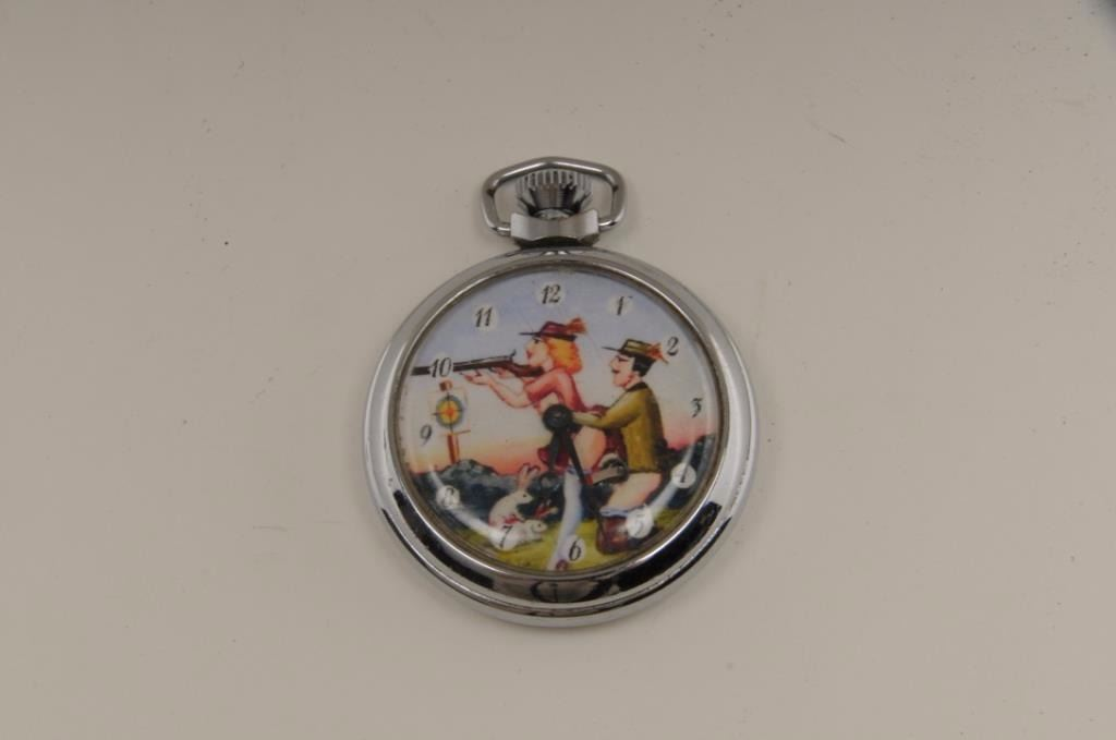 Open face pocket watch with racy man and woman on face