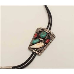 Bolo Tie in Sterling Silver mounted with  Turquoise and Coral. Signed and American  Native made Pre