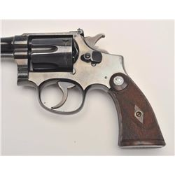 Smith and Wesson Outdoorsman revolver, .22  Long Rifle caliber, Serial #665436.  The  pistol is in n