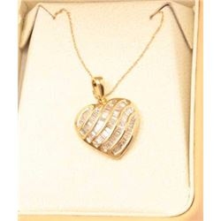 Exquisite 14 karat yellow gold ladies custom  made necklace channel set with over 72  baguette cut d