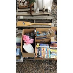 Pallet of books, VHS tapes, and an oar