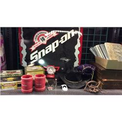 Shelf of collectibles and snap on merchandise
